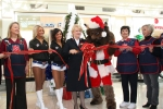 The Salvation Army Women's Auxiliary, The Oklahoma City Thunder girls and Rumble the Bison help cut the ribbon for the 2010 Angel Tree at Penn Square Mall.